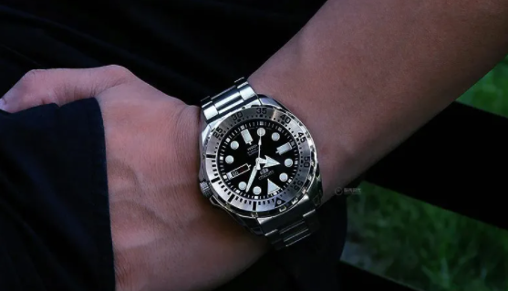 A man needs a dive watch in black and steel
